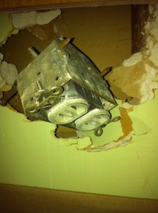 Mysterious electrical socket hidden in the wall.   Could this be the unknown device that our wall switch operates?